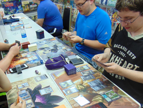 Come play Commander for Magic: the Gathering at World of Games on Monday using the open tables provided.